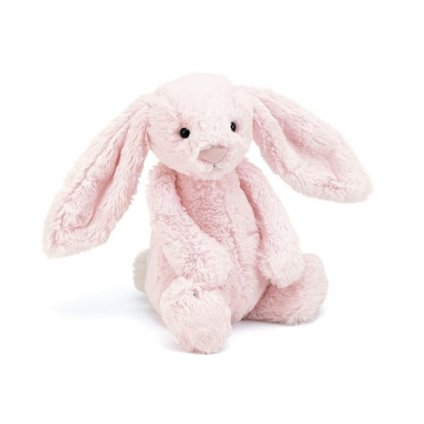A gorgeous baby pink bunny with floppy ears, long arms and a squishable bobtail. Turn her upside down to hear her rattle.