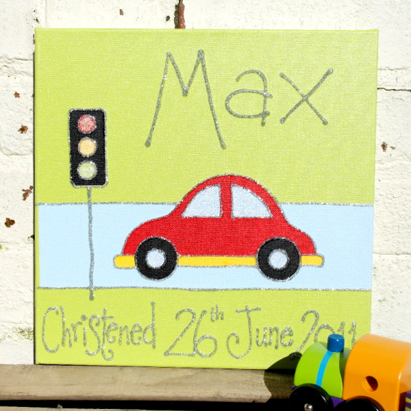 A personalised canvas picture of a red and yellow card stopped at the traffic lights on a blue road.