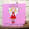 Picture of a cute fairy with red and white stripy socks a red dress and blond hair. Personalised with a name and date of birth. A lovely new baby gift