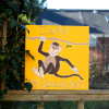 A personalised canvas picture of a chocolate brown monkey holding onto a branch to swing from with a yellow background.