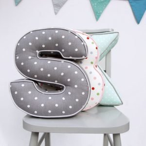 A personalised spotty letter cushion which is 3d. With gorgeous spotty fabric and piping around the edges.