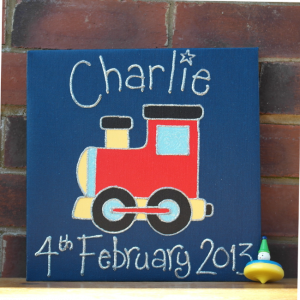 a canvas print of a train personalised with a childs name and date of birth