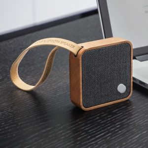 A square wooden bluetooth speaker