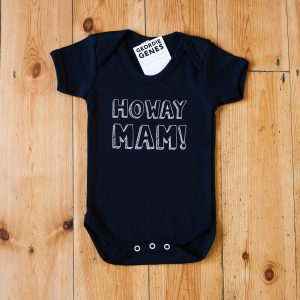 Cotton baby vest with the geordie slogan Howay Mam. Available in black or white and in sizes birth to 18 months
