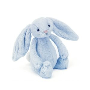 A gorgeous baby blue bunny with floppy ears, long arms and a squishable bobtail. Turn him upside down to hear him rattle.