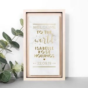 A gorgeous rectangular marble print complete with gold foiled writing and a lovely birch wood frame