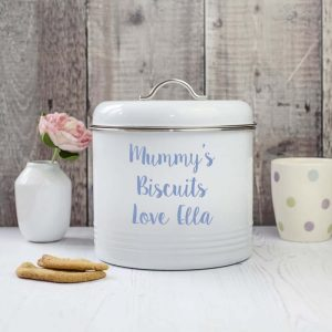 a white metal biscuit barrel with an air tight sealed lid. Personalised with Mummy's Biscuits love Ellie. Can be personalised with any words you choose