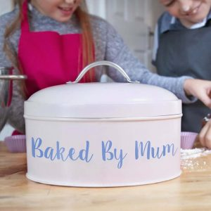 A cream metal cake tin personalised with backed by Mum but you can choose your own personalised message