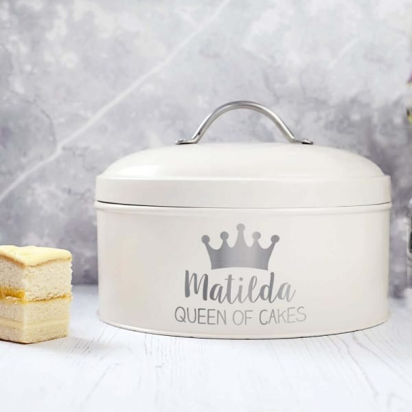A cake tin with a lid which is personalised with the recipients name and a lovely crown on it.