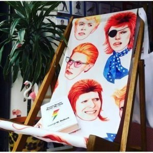 A fabulous Bowie deck chair with a timber frame and with a faces of bowie canvas seat.