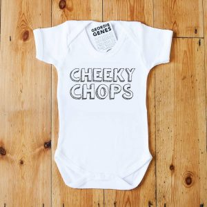 A white geordie baby vest that says cheeky chops in bold lettering in black and white