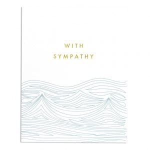 A white card which is 108 mm x 139 mm printed in gold foil with the words With Sympathy on. Underneath the wording are embossed waves which are printed in a teal blue colour.