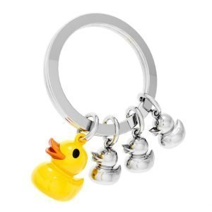 A silver keyring with a letal yellow duck and 3 silver baby ducks