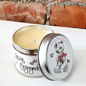 a scented candle in a tin to congratulate a couple on their engagement