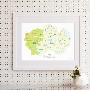 An illustrated map of County Durham A3 print featuring landmarks and areas throughout the county. Shown in a white frame with a white mount
