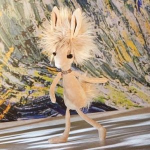 A crazy cuddly toy hare from Jellycat toys. with huge fluffy hair and a spakly choker. Her lovely long eyelashes finish off her glamorous look.