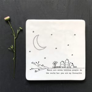 A lovely ceramic square coaster with an image of houses with a moon and stars and the words There are seven billion people in the world but you are my favourite.
