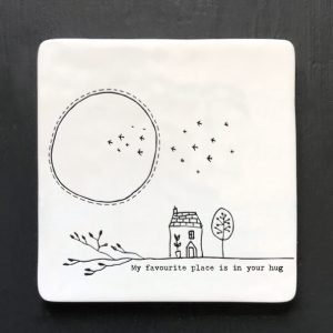 A white My Favourite Place coaster with an image of a house and the moon and birds in the background.