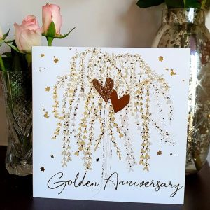 A golden wedding anniversary card with gold hearts on a willow branch of golden hearts