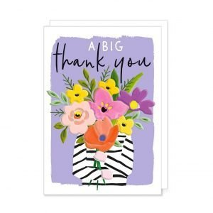 A vibrantly coloured thank you card with a person holding a giant bouquet of flowers that hide their face with the words a big thank you