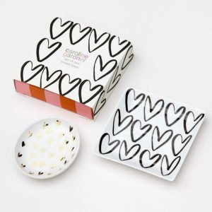 A pair of bone china trinket trays with a heart theme from British designer Caroline Gardner. A perfect birthday or Valentine's day gift.