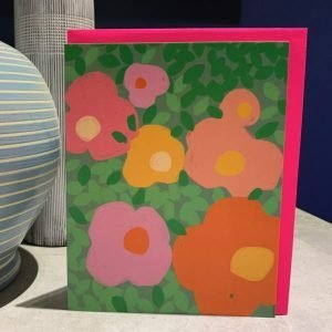 A colourful card with floral print all over it and with no wording making it a blank greetings card