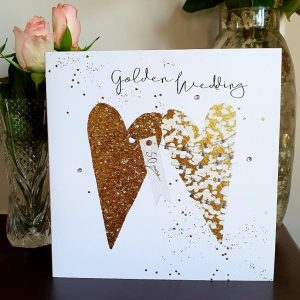 A large golden wedding anniversary with 2 large gold hearts hand finished with crystals