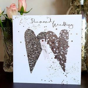 A large diamond wedding anniversary with 2 large silver hearts hand finished with crystals