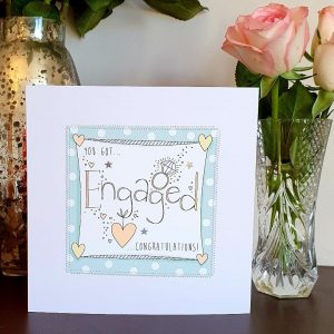 You got engaged congratulations card with hand stitching and silver star decorations