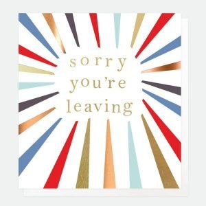 A multi coloured sunray style card with the words 'Sorry You're Leaving' printed inside of it in a gold foild font.