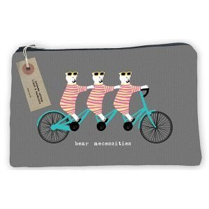 A washable make up bag with an image of 3 bears on a triple tandem with the words 'Bear necessities printed on it.