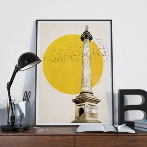 A stunning print of the Grey's Monument in Newcastle with a giant sun behind it and birds flying.
