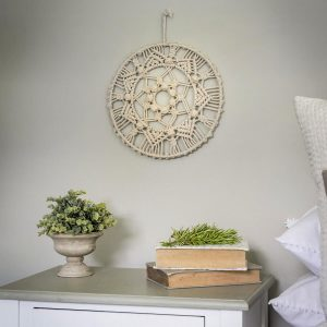 A 30cm diameter circular macrame mandela wall art. Hand made with natural cotton rope this decorative boho wall art will look great in any home
