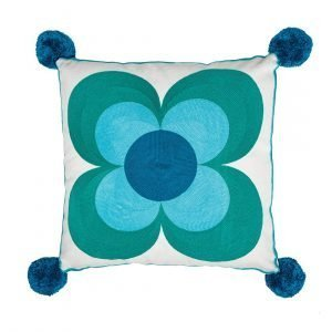 A large cream cotton cushion embroidered by hand with a blue and teal flower. Blue pom poms on each corner and 100% recycled polyester inner