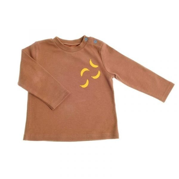 A brown child's long sleeved cotton t shirt with a yellow banana motif. From the Marley Monkey gift set