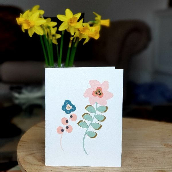 A blank greetings card with 2 modern flowers in pastel shades and gold foil details. Suitable for any occasion