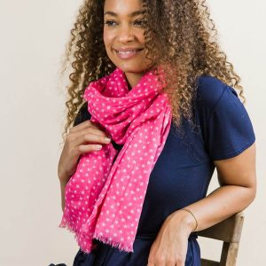Pretty pink scarf made from 100% cotton with a multi star print in white