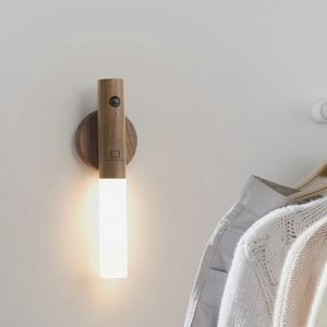 A smart frosted glass light on an adhesive wooden base that can be attached to any wall. The light detaches from the base to be used as a torch. Rechargeable and motion sensitive