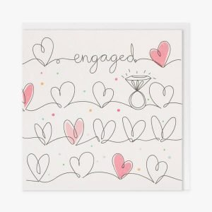 An engagement card with a black line drawing of rows of hearts. Some hearts are coloured in shades of pink. the card is white with little coloured dots. there is engagement ring and the word engaged in the black line drawing