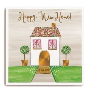 A square card with an image of a colourful house with a spotty roof and lovely matching trees either side of it. The words Happy New Home are embossed and printed with a gold shimmer effect.