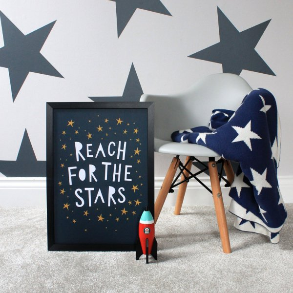 A great children's print with the wording Reach for the Stars printed on it with little stars all over it.