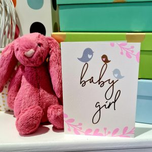 A sweeet little card in biks and gold foil with three little birds sitting on the word baby girl