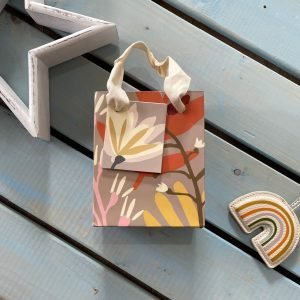 A lovely gift bag with autumn leave and flower design. The bag has a cream ribbon handle and matching gift tag.