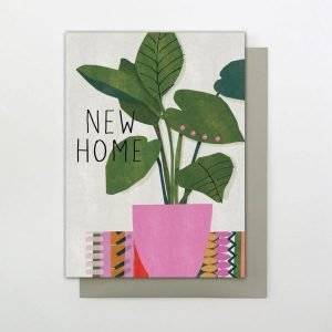 A colourful New Home card with an image of a large pot plant with the words New Home printed on it.