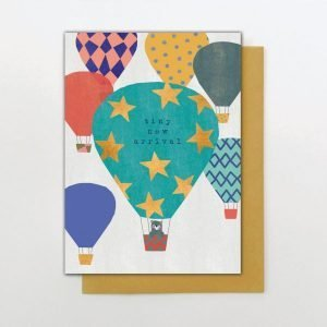 A cute baby boy card from the Big Day out range of cards from Stop the Clock. With an image of loads of colourful hot air balloons. There is a cute little bear in the basket of the biggest balloon and the words Tiny New Arrival are printed on the balloon.
