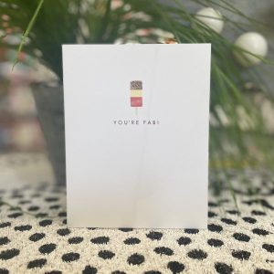 A white card with an embossed image of a fab lolly and the words You're Fab!