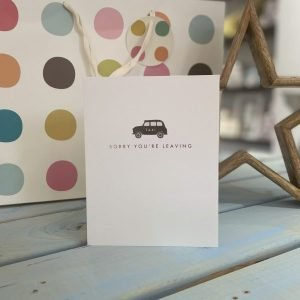 A white card with a little embossed taxi and the words sorry you're leaving underneath