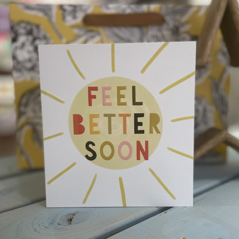 A lovely bright and bold card featuring a big sunshine in bright colours with the words Feel Better Soon in the sun inn different coloured letters