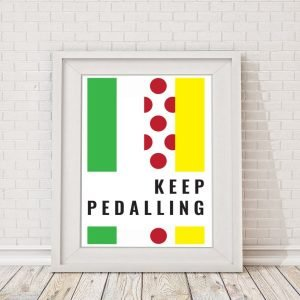 A colourful print with stripes of colour and the words Keep Pedaling on it.