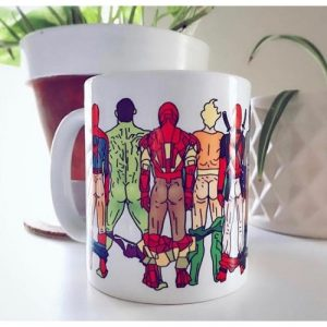 A white mug with cartoon drawn images of superheroes with their backs turned and their bums on show
